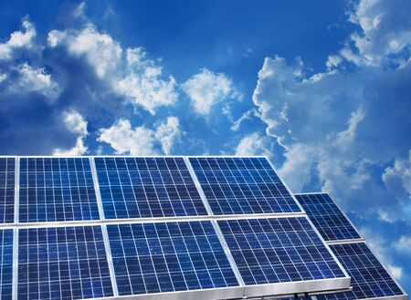 Solar panels on blue sky background photo