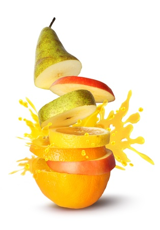 Fruit slices pile juice burst explosion on white background Stock Photo