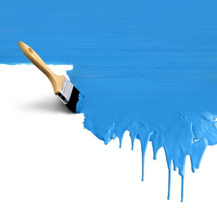 Brush painting vertical dripping blue paint on white background photo