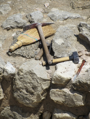 archeologist: Set of archaeologist digging tools on ancient excavation site