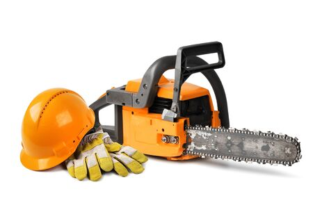 saws: Chain saw and orange hard hat isolated, safety concept Stock Photo