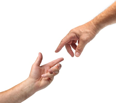 Two hands reaching towards each other white background isolated