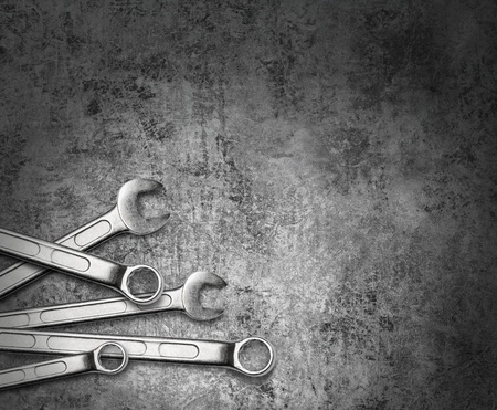 Wrench spanner tools on grunge silver metal background