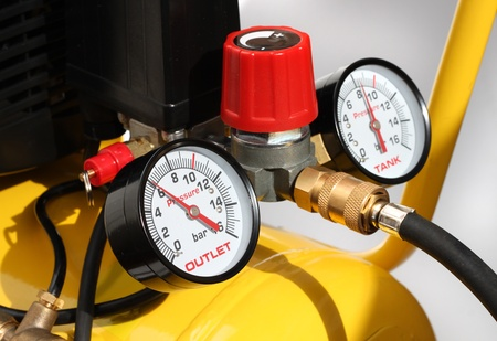 compressed: Pressure meters and compresser safety valve closeup Stock Photo