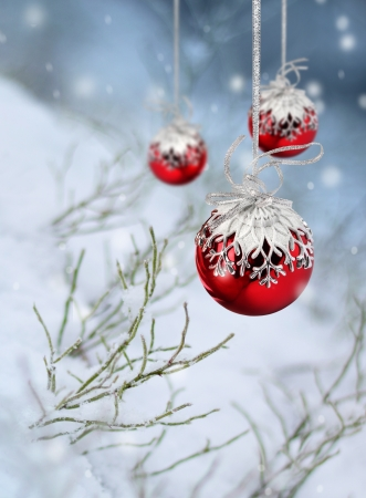 Red Christmas balls in beautiful winter snowfall fantasy photo