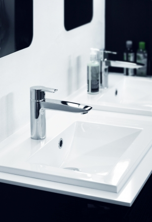 Modern bathroom detail in black and white Standard-Bild