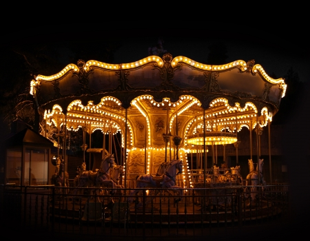 Traditional carousel wheel empty night black background