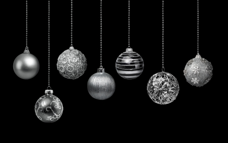 silver ribbon: Seven silver decoration Christmas balls collection hanging, black background isolated