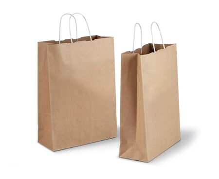 Two brown shopping paper bags isolated on white background Stock Photo - 17470450