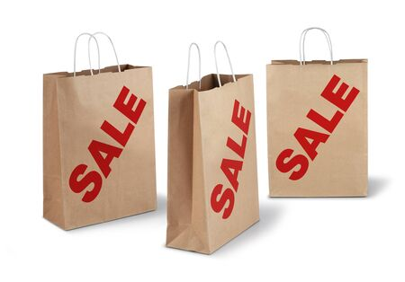 Three brown shopping paper bags red sale text isolated Stock Photo - 17470448
