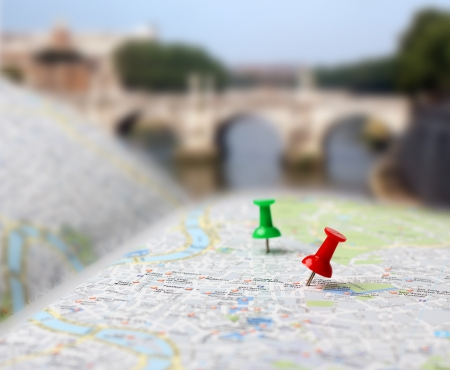 Push pins pointing planned travel destinations on tourist map, blurred background Stock Photo