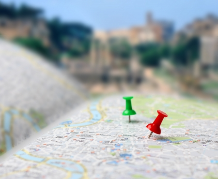 thumbtack: Push pins pointing planned travel destinations on tourist map, blurred background Stock Photo