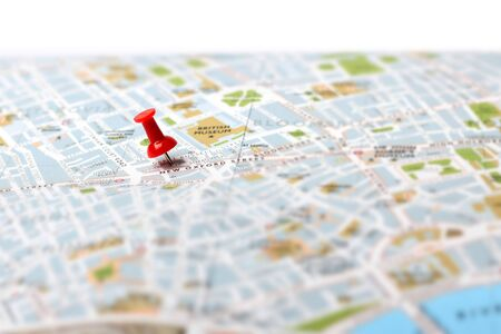 push pins: Red push pin pointing planned travel destination on map