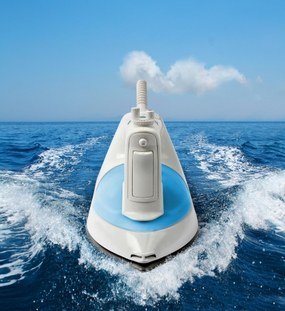 Easy homework concept ironing, flat-iron steaming on sea Stock Photo