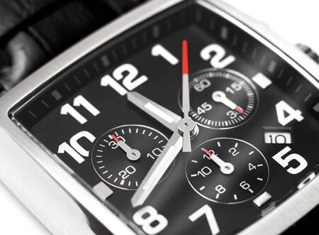 chronograph: Modern steel chronograph wristwatch closeup time concept
