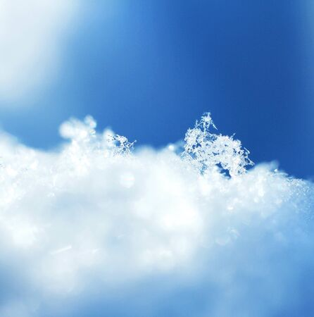 Frozen snow crystals macro blue white winter background photo