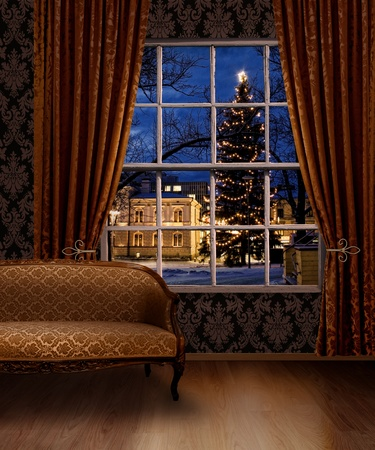 winter wallpaper: Christmas town view window from classic furniture interior room Stock Photo