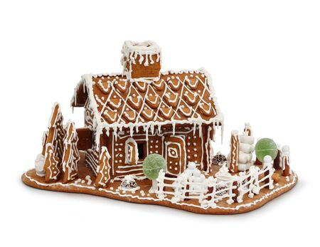 Homemade gingerbread house cottage isolated on white photo