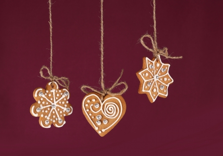 Christmas gingerbreads hanging in traditional linen string Stock Photo - 20179679