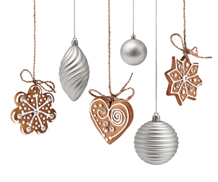 Christmas gingerbreads and glass decoration hanging isolated