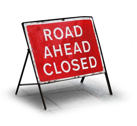 Grungy road closed sign isolated on white background Foto de archivo