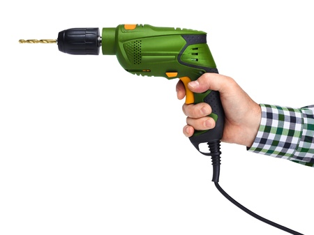 electric drill: Male worker hand holding electric drill, isolated on white Stock Photo