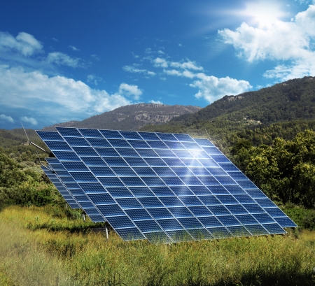 Solar energy panel collectors reflecting sunlight glare photo