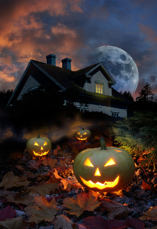 Halloween pumpkin lanterns in haunted house garden photo