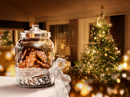 home baked: Gingerbread cookies jar Christmas tree room background
