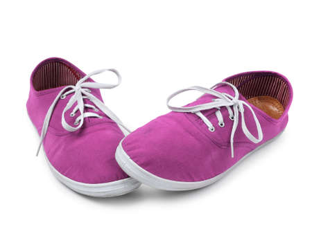 shyness: Shy pink sneakers isolated on white, shyness concept