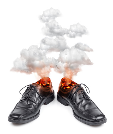 Burning hot business shoes, stress or pain concept photo