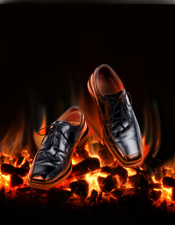 hectic: Business shoes dancing over burning hot coal fire