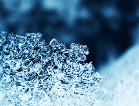 Snowflake ice crystals macro closeup dark blue background
