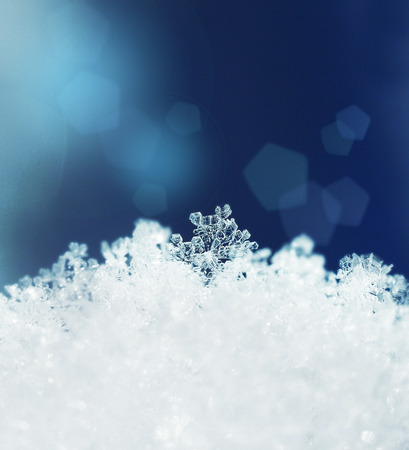 Beautiful snow crystals snowfall winter season background photo