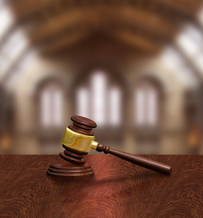 Judges gavel on courthouse table, justice concept photo