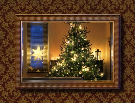 Illuminated Christmas tree seen through wall mirror