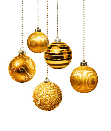 Five gold decoration Christmas balls hanging isolated Foto de archivo