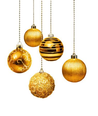 Five gold decoration Christmas balls hanging isolated Standard-Bild