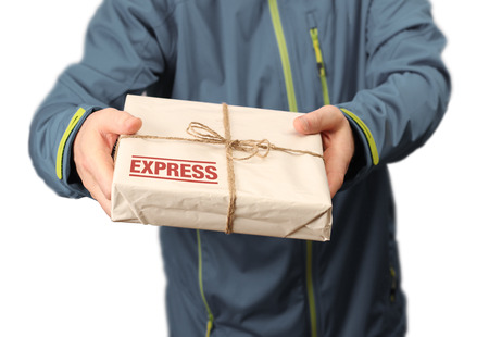Male courier service worker or postman holding express delivery package photo