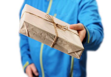 Male courier service worker or postman holding parcel delivering package photo
