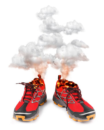 Smoking red hot running sport shoes isolated on white background photo