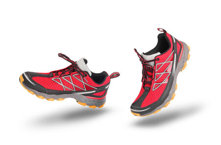 running shoes: Running red sport shoes isolated on white