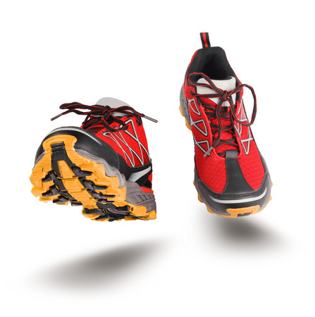 Red running sport shoes seen front, isolated on white background photo