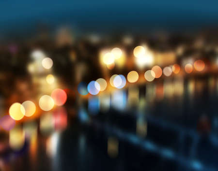 Blur city lights colorful bokeh reflection over water photo