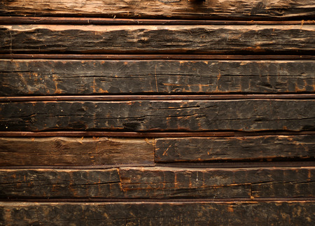 Old smutty log wall of rustic wooden cabin