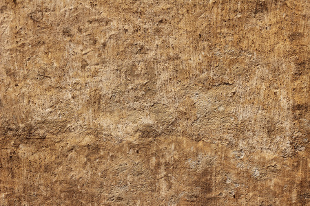 Rough brown plaster sandstone  wall coarse texture background