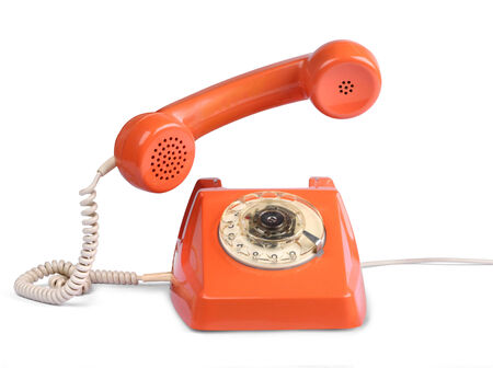 retro telephone: Vintage telephone of with handset lifted, isolated on white Stock Photo