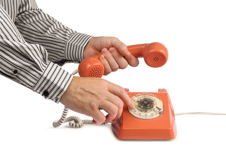 hang up: Male hands making phone call with vintage telephone, isolated on white