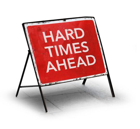 risks ahead: Grungy road sign hard times ahead isolated on white background