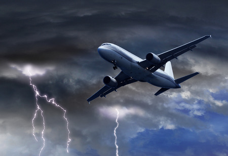 Passenger air plane approaching turbulent thunder storm